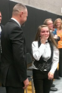 Kendria Hawks wipes away tears after seeing her father Chris Burgess, left.