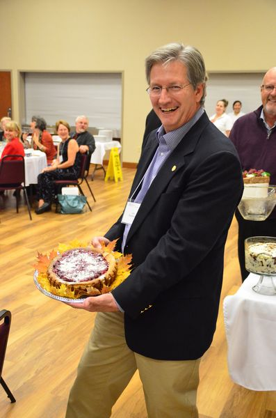 The final event of the evening was a dessert scramble in which tables bid against each other for the privilege of first pick at the dessert table. Here, John Rubenkonig shows off his prize
