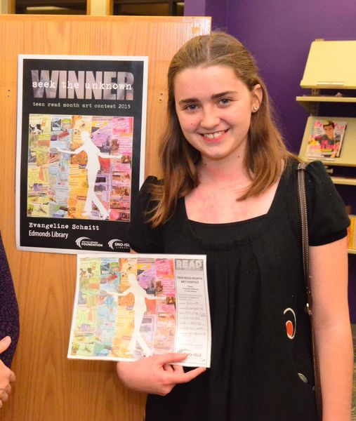 """Evangeline Schmitt, Edmonds-Woodway 9th grader, holds up her original artwork for the annual Teen Read Month art contest. The work is a collage reflecting the contest theme, """"seek the unknown."""""""