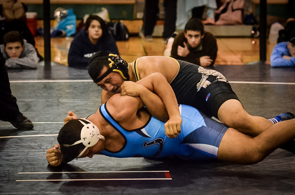 Lynnwood's Manuel Vazquez faces Meadowdale's Tim Smith.