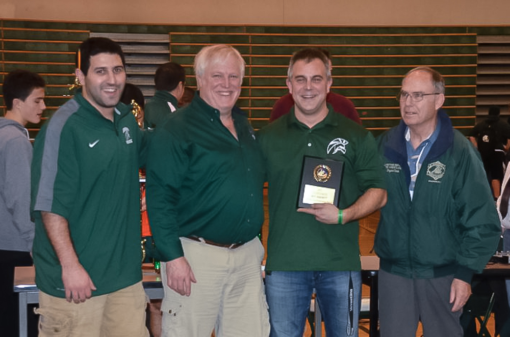 Edmonds-Woodway assistant coach Rich Vulliet receives the Mike Hanchett Coaches Award for Good Sportsmanship. A former E-W and College Place Middle coach, Hanchett presented the award.