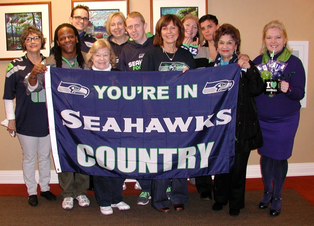 Meeting attendees show off their Seahawks attire.