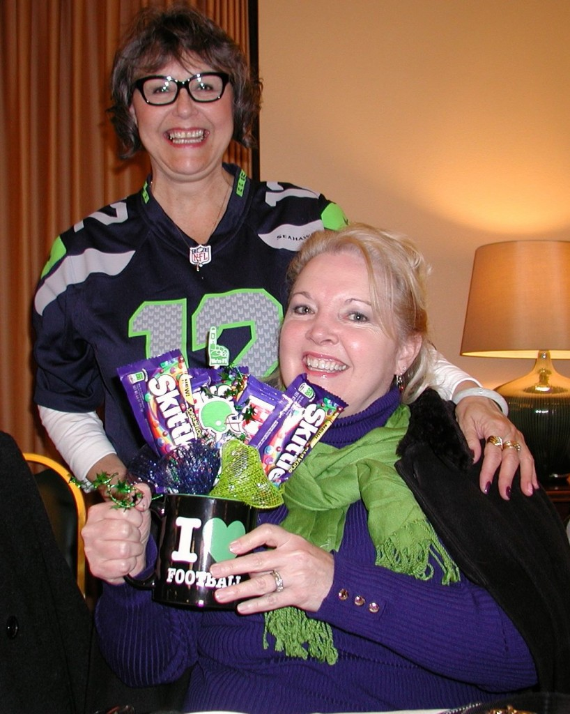 Chamber Membership Director Valerie Claypool presents Julia Van Buskirk of the Main Street Edward Jones office with her breakfast raffle prize -- a football mug filled with Skittles (a favorite  of Seahawk player Marshawn Lynch), from the Edmonds Conference Center.