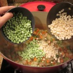 Now add the frozen corn and frozen peas. I added about a bowl of each, but add as much as you like.