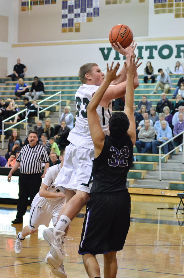 Travis Bakken had 21 points and 11 assists. (Photos by Karl Swenson)