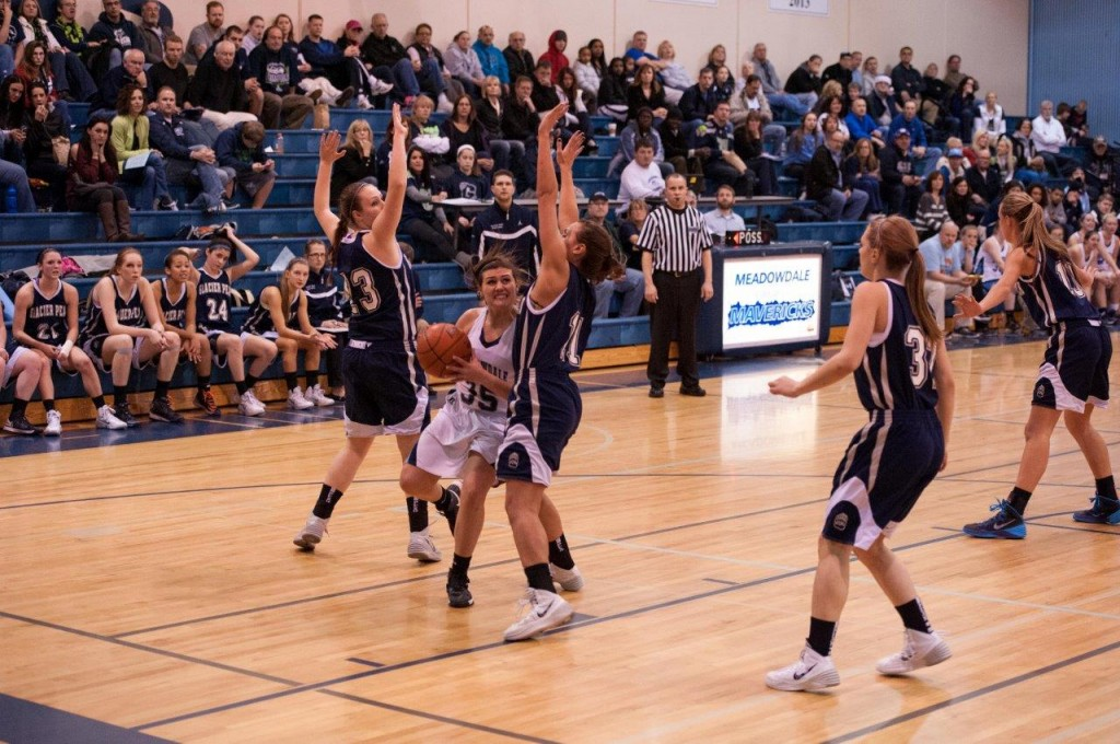 Meadowdale's Jackie Barhoum drives to the hoop at Friday night's game against Glacier Peak. (Photo by Ken Pickle)