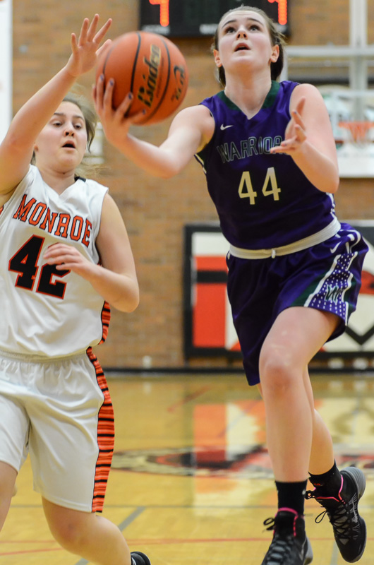 Missy Peterson, shown here, and Moni Jackson led the Warriors in scoring with 13 apiece. (Photo by Karl Swenson)