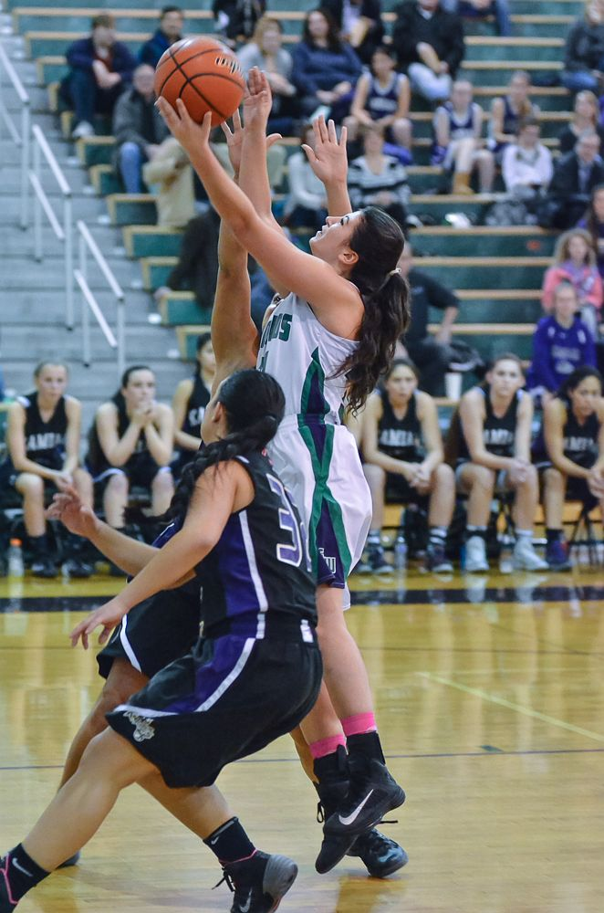 Maddy Nealy defends against Kamiak's Nora Aboulhosn. (Photos by Karl Swenson)