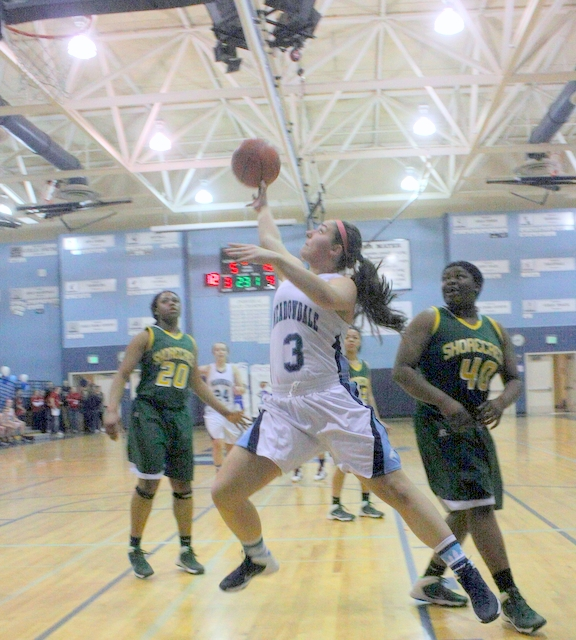 Meadowdale's Ciarra Hart (3) attempts a lay-up, while Shorecrest's Onyie Chibuogwu (20) and Uju Chibuogwu (40) watch.