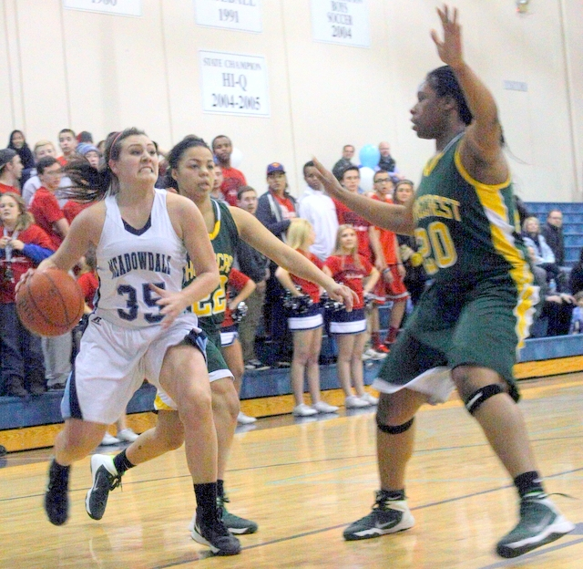 Meadowdale's Jaclyn Barhoum (35) heads to the hoop while being defended by Shorecrest's Savannah Tidwell (left) and Onyie Chibuogwu.