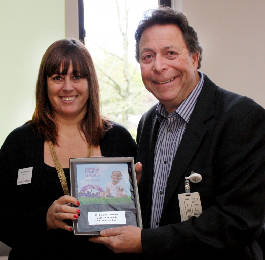 Jean Alenbach, March of Dimes state director, presents an award to David Jaffe, chief executive at Swedish/Edmonds and 2014 chair of the March of Dimes Leadership Cabinet for the hospital's fundraising achievement in 2013. Award presentations were made at Monday's kick-off meeting for this year's event on April 26, 2014. The Snohomish County March for Babies will take place in Edmonds for the first time. For more information, visit: http://tinyurl.com/kqqtt28