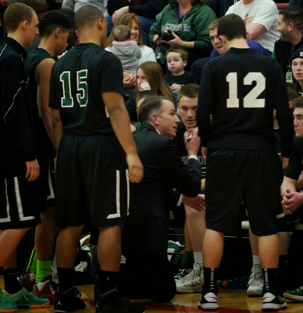 E-W Coach Steve Call talks with his team during a time out.