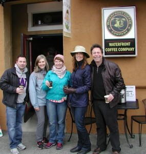 Waterfront Coffee owner Victoria Balas, second from left, welcomes the walkers.
