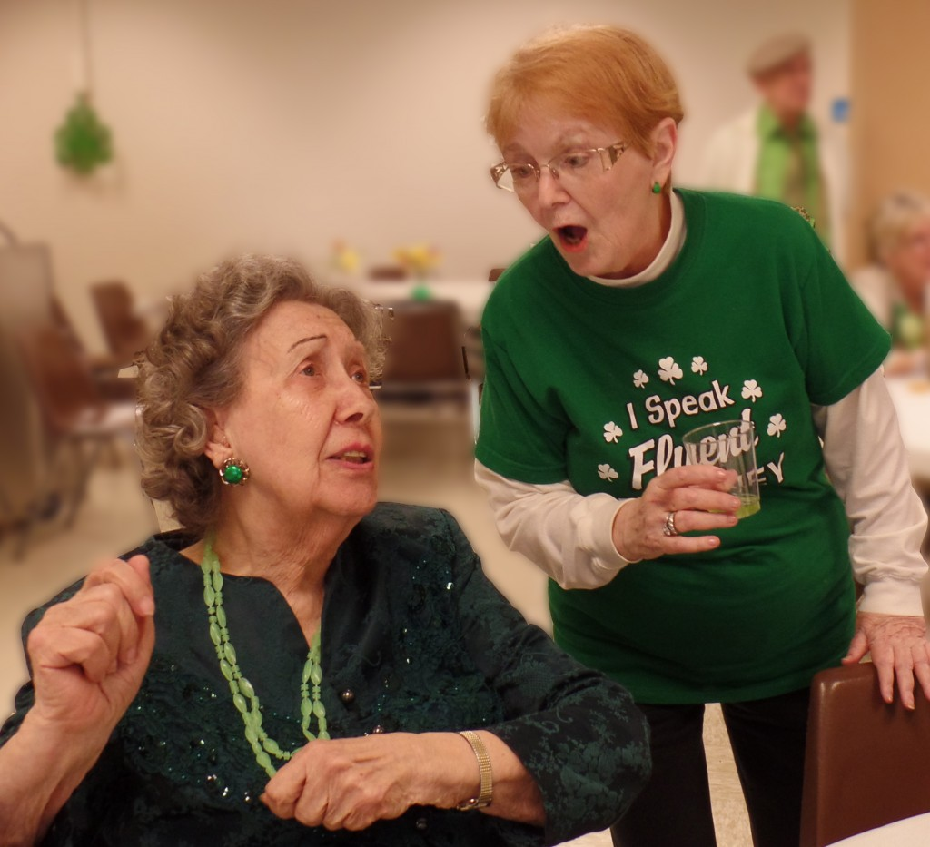 Lois Anderson and Lauman sing along.