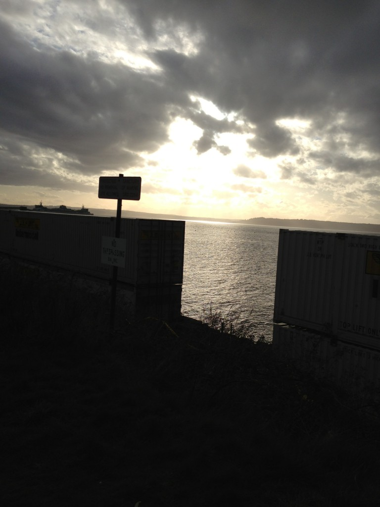From Jennifer Benson, the sun breaking through the dark clouds as the BNSF train is stopped on the tracks in front of Seaview Avenue Friday.