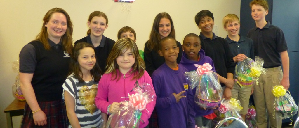 As one of their school service projects, eighth graders at Edmonds-based Holy Rosary School played 'Easter Bunny' Tuesday and delivered Easter baskets to students at College Place Elementary School.
