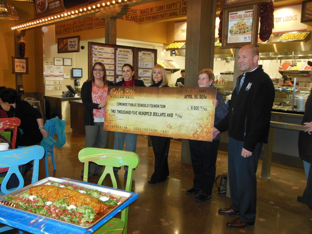 Mexican restaurant Café Rio, which held its grand opening and ribbon cutting at Alderwood Mall Wednesday, also made a $2,500 gift to the Edmonds Public Schools and Alumni Foundation. Included in check presentation, from left, are Nicole Hurley, Café Rio; Deb Anderson, foundation executive director; Brenda Klein and Linda Fitzgerald of the foundation board; and Nick Brossoit, Edmonds School District superintendent.