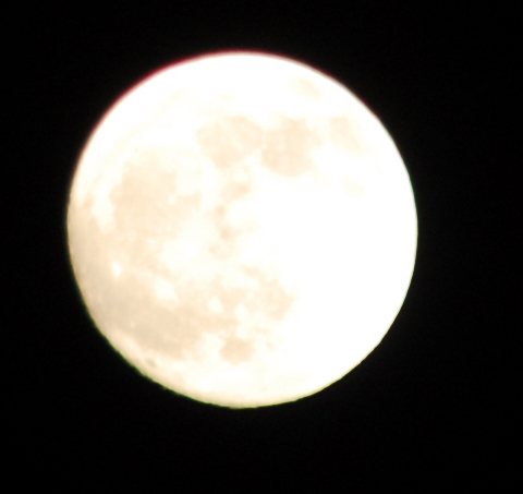 From Ken Sjodin, a full moon over Edmonds Sunday. Look for a red moon Monday.