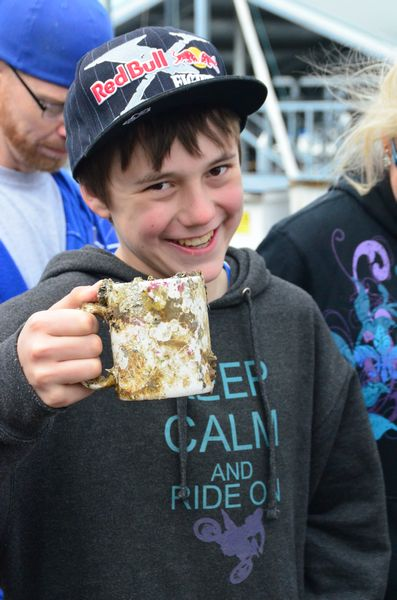 """Gabe Fullenkamp shows off a barnacle-encrusted coffee mug brought up the dive teams.   Also a certified diver, 12-year-old Fullenkamp goes to school in Colville but spends summers and other free time in Edmonds with his father. He has attended Crawley's summer camp at Sunset Bay for the past two years. """"I sure didn't want to miss this event,"""" he said."""