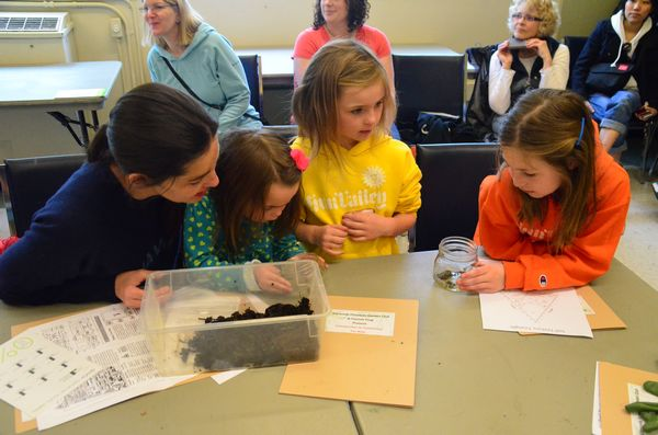 """Mom Kelly Oliver brought daughters Harper, Adison and Paige to the workshop. """"I love to garden, and I think it's great to have special event like this where kids can learn about something that can become a lifetime passion,"""" she said."""