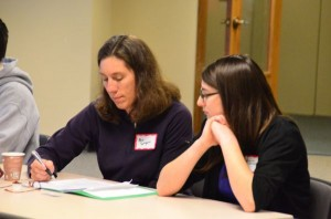 Exchange student Klara Gaspers and her mother Pam check over the evening's agenda and proposed trip itinerary.