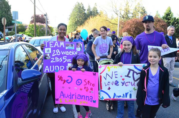 """Many marchers have a personal connection to the work of the March of Dimes and have been touched by their work.  """"Team Audrianna"""" is comprised of the family of Audrianna Mestas who was born at 28 weeks weighing a mere 2 lb, 5 oz.  Today, seven months later, little Audri is still at Children's Hospital but is doing well and will soon be able to come home to her family.  """"The March of Dimes made this possible for us,"""" said mom Brittney Mestas. """"We're here to say thanks on behalf of Audri.""""  L to R, mom Brittney Mestas, sisters Jayda and Alexis, and dad Jeremy."""