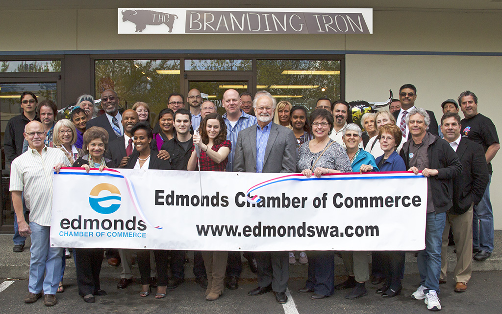 The Edmonds Chamber of Commerce hosted a ribbon-cutting May 9 for the Branding Iron, an all-in-one graphic design, printer and marketing firm at 120 W. Dayton, Ste. B-1. (Photo by Renata Kleinert)