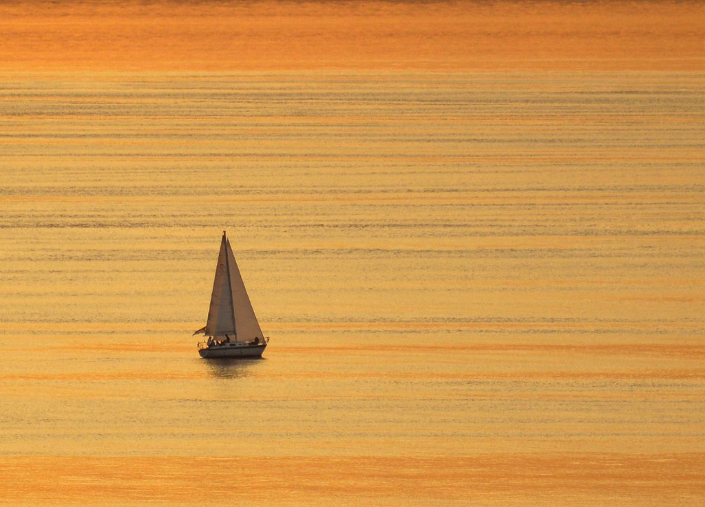 From Dan Palmer, a sailboat glows in the sunset off Edmonds Thursday.