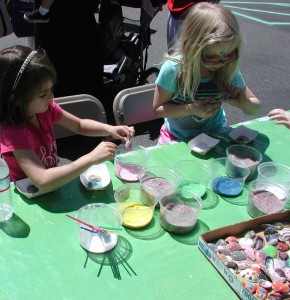 A free children's play area featured a variety of craft projects, courtesy of Thayer Cueter of Just Frogs and Friends Amphibian Center. Here, visitors decorate shells with paint and glitter. Cueter shared that she recycles the shells from local waterfront restaurants; cleaning and bleaching them before they are reused.