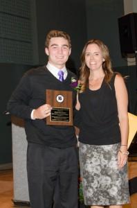 Tate Budnick receives his award.