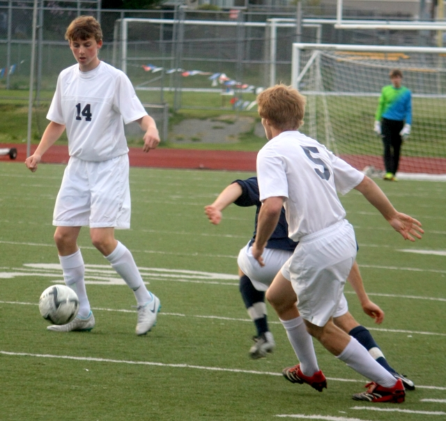 34 Meadowdale's Stuart Smith (14)  looks to pass the ball as teammate Colton Davis (5) watches. (Photos by David Pan)