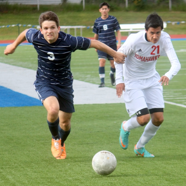 Meadowdale's Griffin Over (3) battles Marysville-Pilchuck's Cristian Correa-Avila (21) for the ball during a 3A District 1 playoff game Saturday at Shoreline Stadium. (Photos by David Pan)