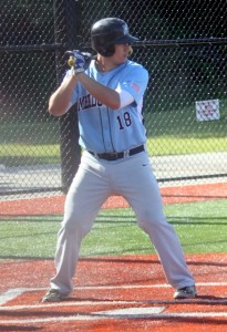 Meadowdale's Garrett Walsh waits for the pitch against Shorewood. (Photo by David Pan)