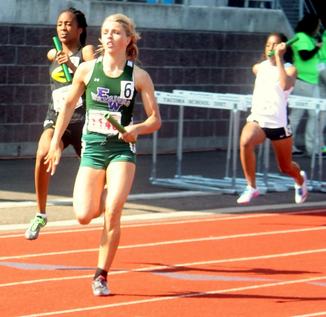 Edmonds-Woodway's Claire Popke finishes the final leg of the 400 relay at the 4A State Track and Field Championships Friday at Mount Tahoma Stadium in Tacoma. The Warriors placed second in their preliminary heat and advance to Saturday's finals.  (Photos by David Pan)