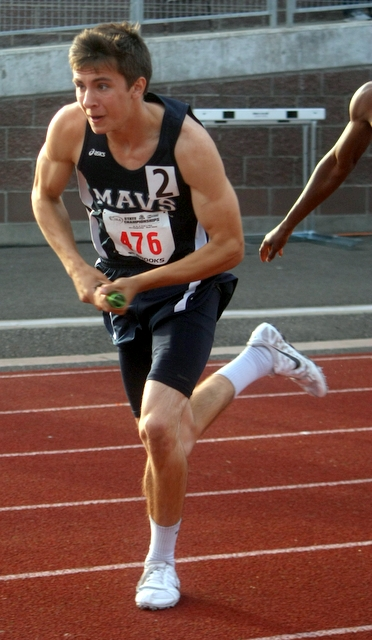 Meadowdale's Trevor White runs the final leg of the 1,600-meter relay during a preliminary heat at the 3A State Track and Field Championships Thursday.