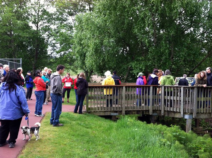 Earth Works' Keeley O'Connell leads visitors on today's Marsh Walk.