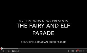 "Edith Farrar, children's librarian at the Edmonds Library, leads the annual Fairy and Elf Parade from the Edmonds Library to the Garden Market, where children create a gift for mom through the annual ""Kids Plant for Moms Day."""