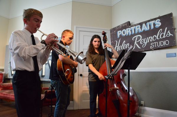 Musical entertainment was provided by the Edmonds/Woodway High School Jazz Trio, featuring Jackson Kettel on trumpet, Mason Fagan on guitar, and Luis Ross on bass.