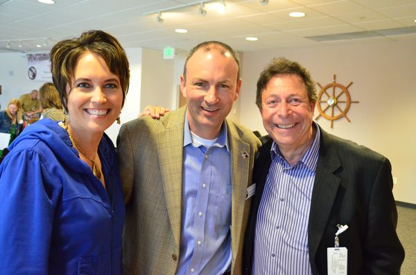 Mike Schindler, organizer of Operation Military Families and one of the main organizers of the Fashion Forward event is flanked by communications consultant Carolyn Douglas and David Jaffe, Swedish/Edmonds CEO.