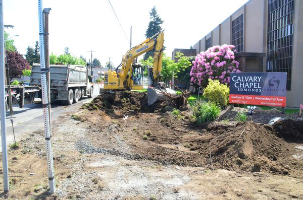"""Crews remove some landscaping from the grounds of Calvary Chapel to make way for the new roundabout. """"We'll be putting in new landscaping later this summer,"""" said a member of the work crew."""