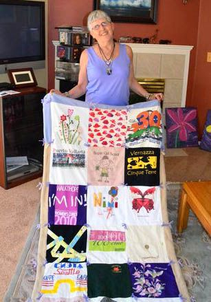 """Frannie Cohen shows off her latest afghan.  """"This one is made from T-shirts,"""" she says.  All her afghans are donated to hospitals, children's centers, charitable auctions and other places where they can help people in need."""