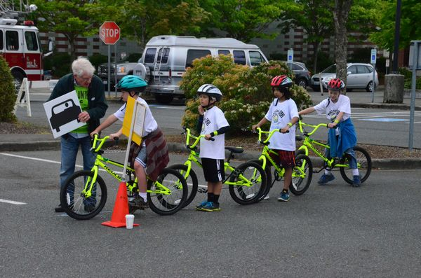 Competitors line up for their turn to navigate the obstacle course at the Cascade Bicycle Club's bicycle rodeo.
