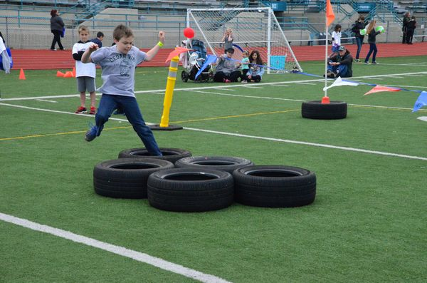 Logan Middleton, Cedar Way 5th grader, dives into the tire obstacles with obvious gusto.