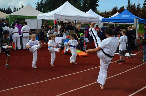 The annual Edmonds Fitness Expo organized by Edmonds Parks and Recreation attracted more than 50 local businesses and hundred of visitors Saturday morning. Visitors to the Bailey's Taekwon Do booth got the chance to try on the uniform and get instruction in some basic Taekwon Do moves from teacher Nikka Gaviola. (Photos by Larry Vogel)