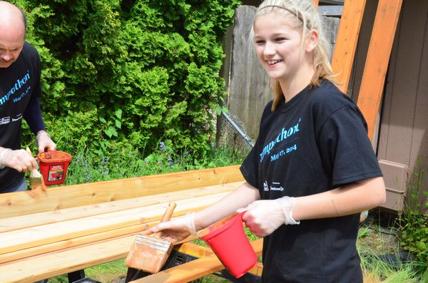 Chermak staff even drafted family members to help.  Here Allison Elkins, daughter of Chermak employee Jon Elkins, puts a coat of stain on some decking