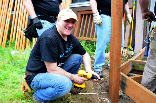 """Glenn Berkwitt, a project manager for Chermak, stepped out of his administrative duties to get his hands dirty in this year's Rampathon.  """"We've got more supervisors here than workers,"""" he laughed."""