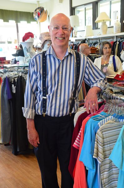 """Senior Center Director Farrell Fleming, a self-confessed thrift store fashionista, shows off his snazzy shirt and suspenders, both recent purchases from the Senior Center store. """"This may not be the biggest store around, but we've got the best stuff,"""" he said."""