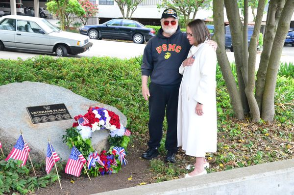 Myra Rintamaki placed the first wreath on the memorial in memory of her son, Steven, who lost his life in 2004 in the Gulf War.  She is accompanied by Mike Reagan of the Fallen Heros Project.  Reagan, who draws portraits of fallen military heros, had earlier presented Rintamaki with a portrait of her son.  The wreath was made by students in the Edmonds Community College horticulture program.