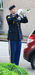 """As the wreaths were lain, Marine First Sergeant Chris Edward joined Officer Debbie Dawson of the Edmonds Police Department for """"echo taps"""" where two bugles echo notes from either side of the gathering."""