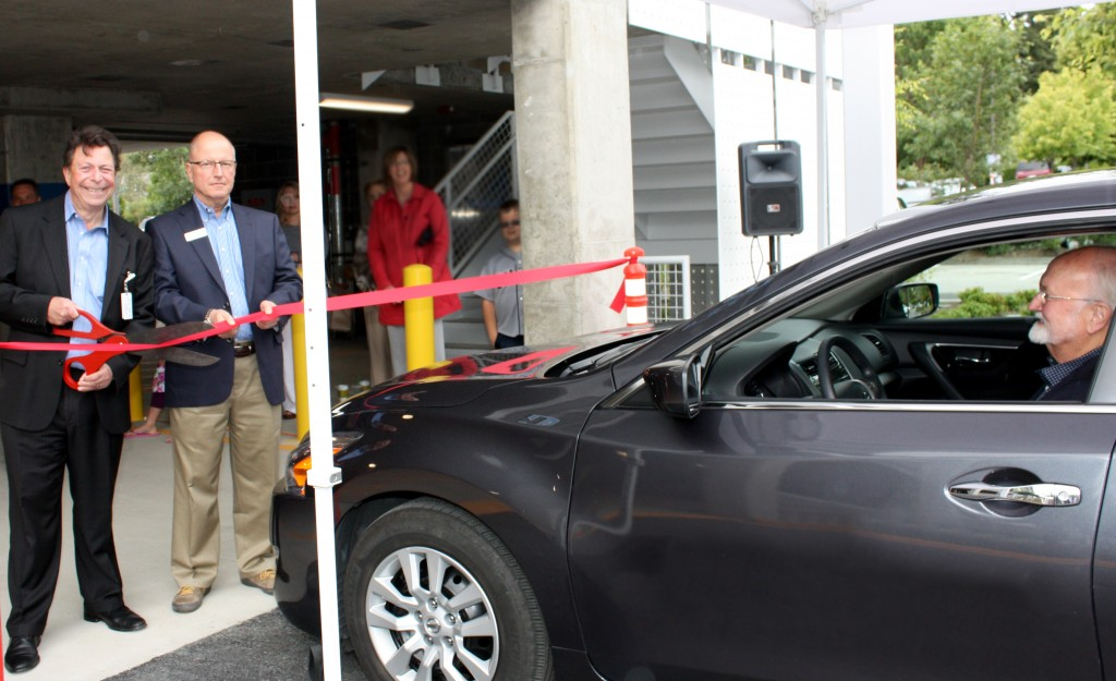 A ribbon-cutting ceremony opens a new Swedish/Edmonds three-story parking garage with more than 350 free parking spaces. Cutting the ribbon are David Jaffe, chief executive at Swedish/Edmonds and Carl Zapora, superintendent at Verdant Health Commission as Edmonds Mayor Dave Earling waits to enter the garage. The construction project began six months ago and finished on time and under budget, Swedish/Edmonds said. Now that the garage is complete, the $63.5 million, 77,000-square-foot expansion work will begin. A new emergency department, urgent care center, outpatient diagnostic imaging center, spacious public lobby and more are projected to open in late 2015. (Photo courtesy Swedish/Edmonds)